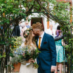 Bride & groom kissing in gardens of Southwark Registry Office