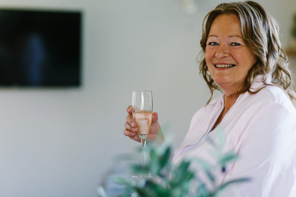 Mother of the Bride holding champagne glass