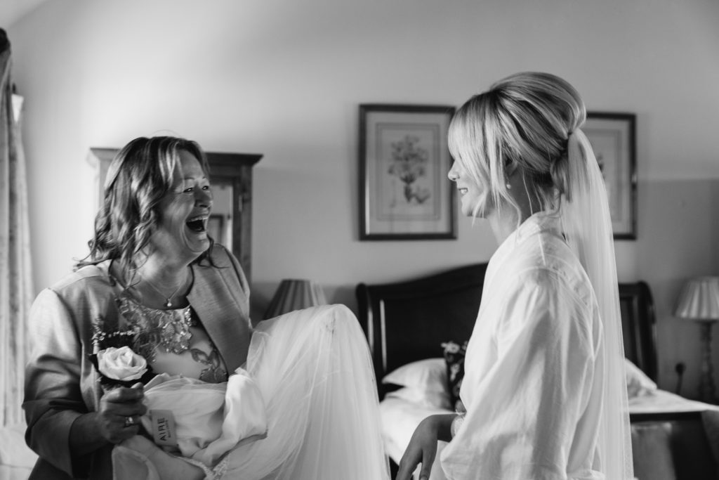 Mother laughing with Bride