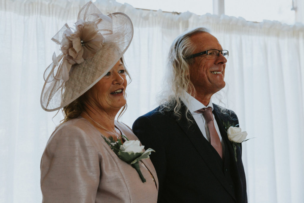 Parents of Bride awaiting her reveal