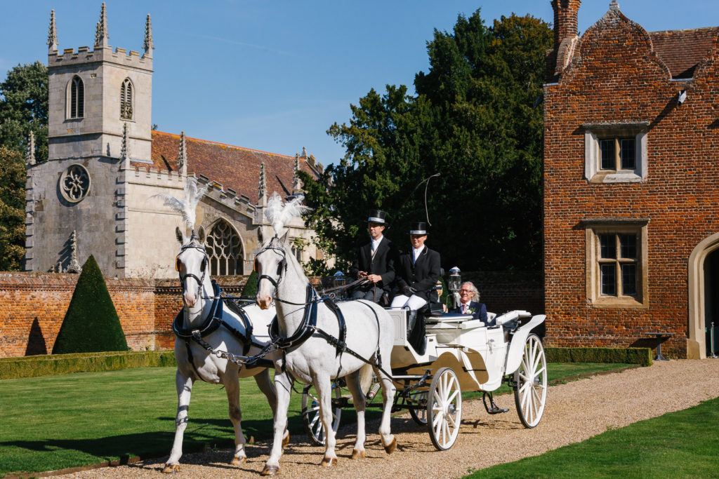 Horse & Carriage taking bride to ceremony