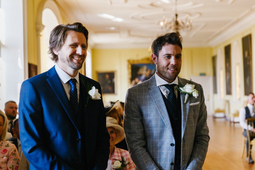 Groom and best man awaiting arrival of Bride