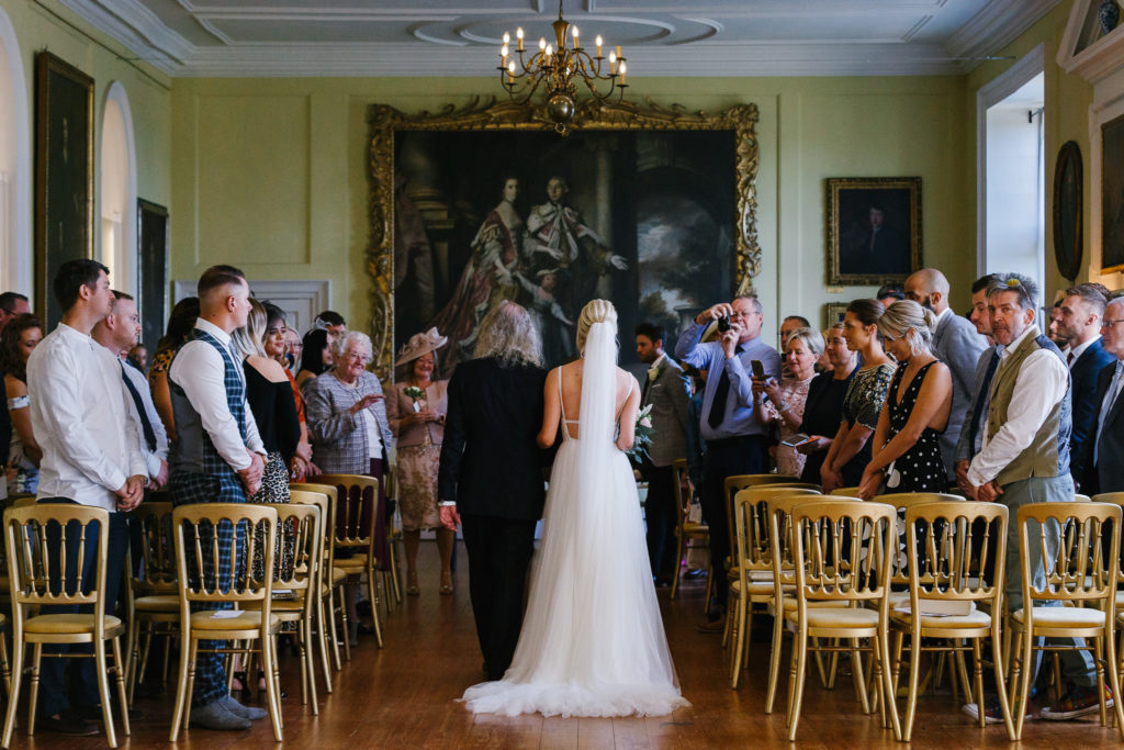 Father & Bride walking down ailse in The Long Gallery at Doddington Hall