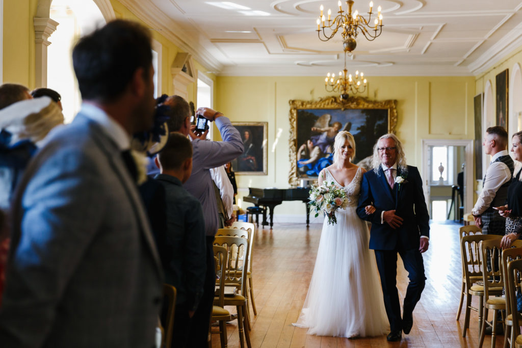 Father & Bride walking down the aisle at Doddington Hall's Long Gallery