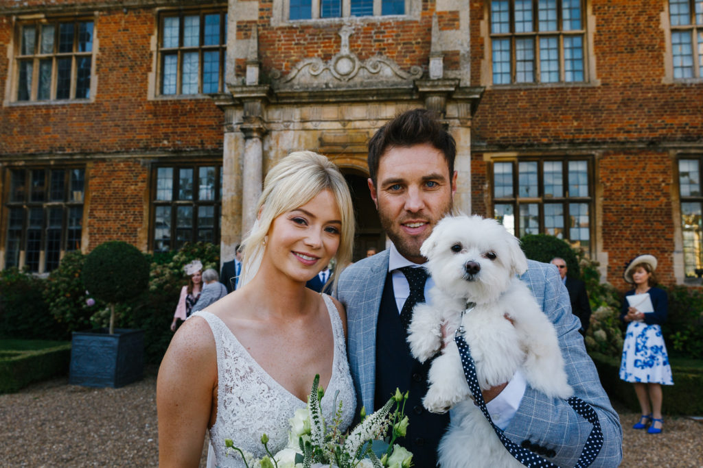 Newly married couple with their dog