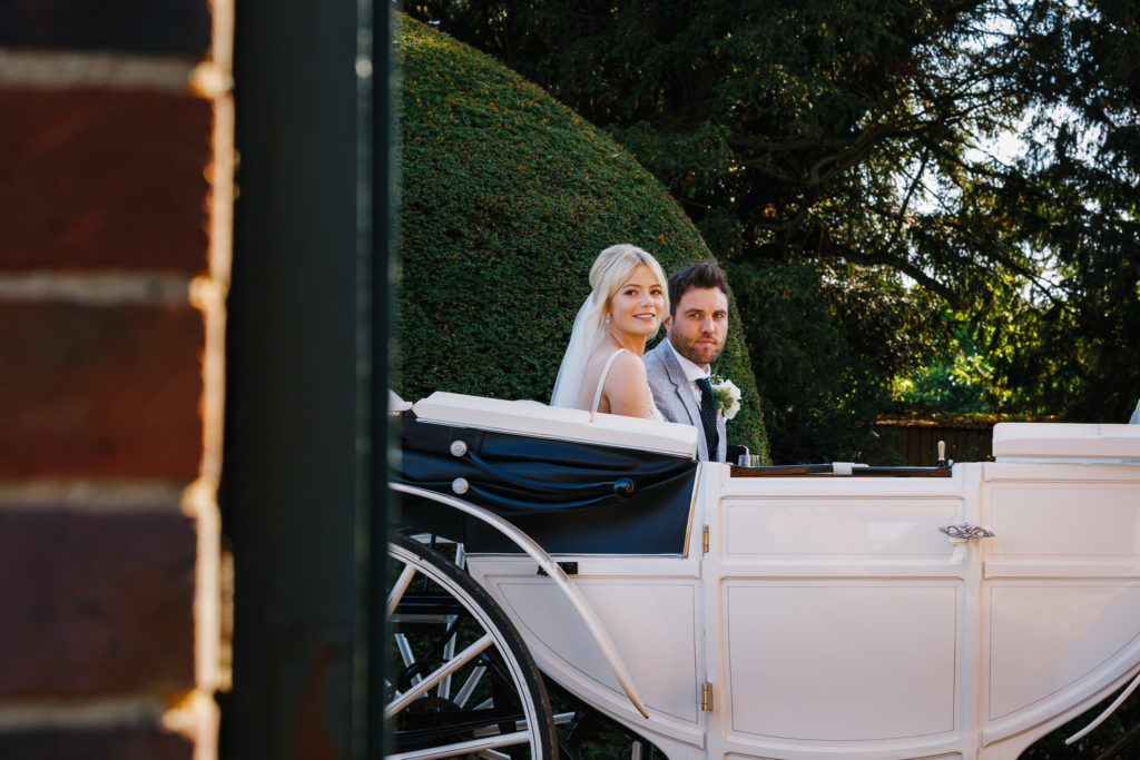 Bride & Groom in horse & carriage