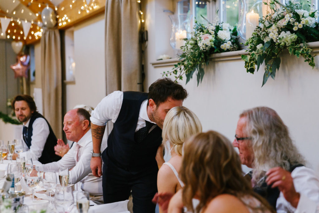 Groom kissing new wife